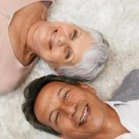 Shot of a happy-looking senior couple lying down and smiling