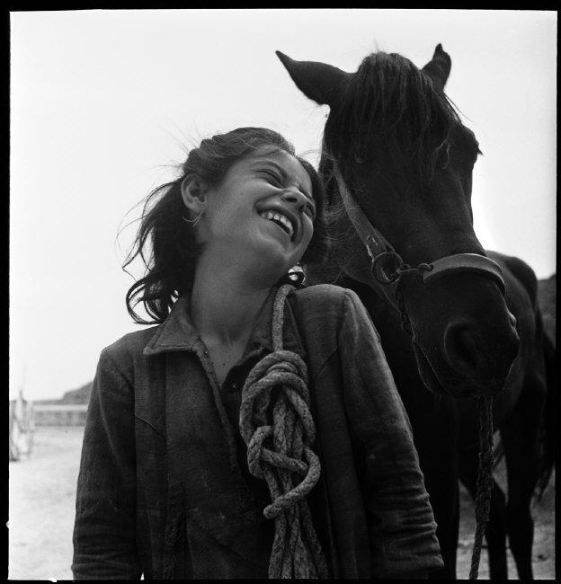 A peasant girl leading her family's horse back from the fields to her cave home. Matera, Basilicata, Italy. 1948. © David Seymour / Magnum Photos