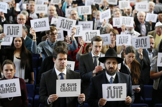 Members of the Board of Deputies of British Jews hold up signs during an event in London