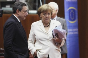 File phot of ECB President Draghi talking to Germany's Chancellor Merkel during European Union leaders summit in Brussels