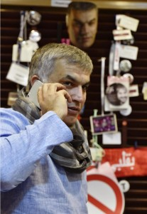 Bahrain's Human Rights Activist, Rajab, takes a call in his home office a day before being sentenced to six month in jail over remarks critical of the state, in Budaiya west of Manama
