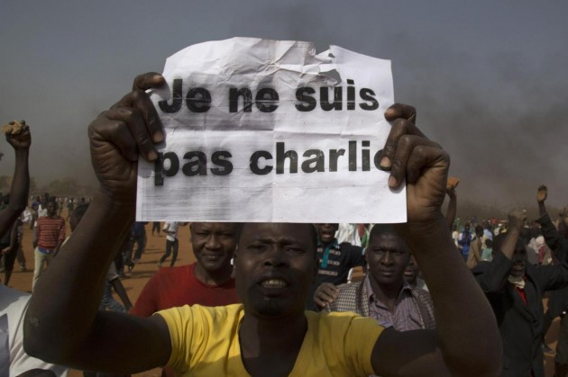 A man holds a sign during a protest against Niger President Issoufou's attendance last week at a Paris rally in support of French satirical weekly Charlie Hebdo, in Niamey