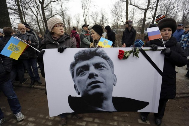 People attend a march to commemorate Kremlin critic Nemtsov in central St. Petersburg