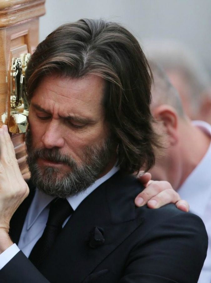 "File photo dated 10/10/15 of actor Jim Carrey carrying the coffin of ex-girlfriend Cathriona White, as the actor is facing a wrongful death lawsuit over the suicide of his ex-girlfriend. PRESS ASSOCIATION Photo. Issue date: Tuesday September 20, 2016. Mark Burton, the estranged husband of Ms White, has lodged a complaint claiming the 54-year-old star of The Mask used his ""immense wealth and celebrity status"" to illegally obtain and distribute prescription drugs involved in her death. See PA story COURTS Carrey. Photo credit should read: Niall Carson/PA Wire"