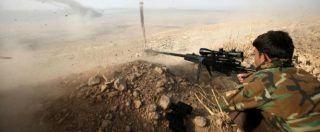 A Kurdish peshmerga fighter shoots during an operation to attack Islamic State militants in the town of Naweran, near Mosul, October 23, 2016. REUTERS/Azad Lashkari