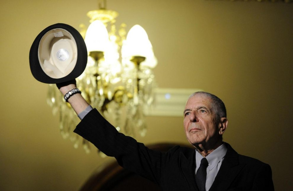 Canadian singer-songwriter Leonard Cohen gestures during a tribute in Gijon, northern Spain on October 19, 2011.   REUTERS/Eloy Alonso/File Photo