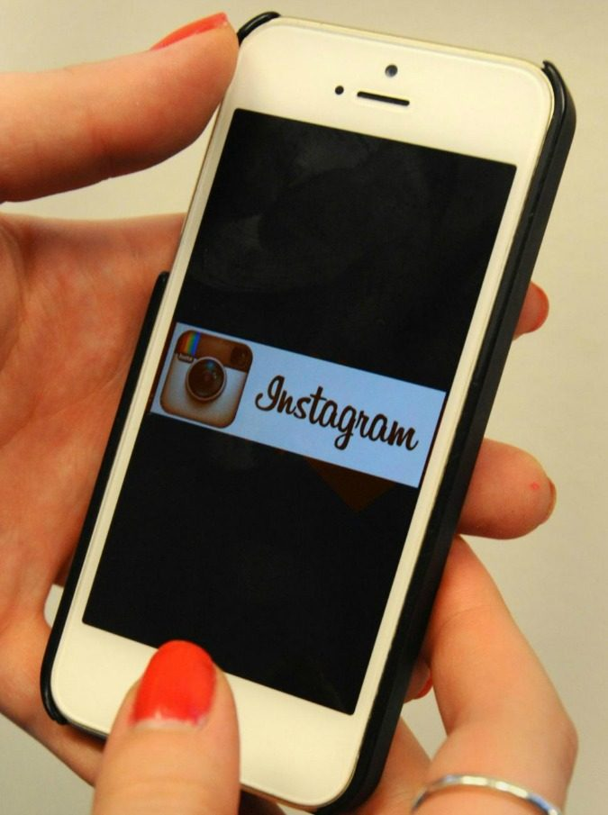 File photo dated 29/01/15 of the Instagram logo on an Apple iPhone 5S. Last week Instagram reached the milestone of 400 million users, and now it celebrates its fifth birthday. PRESS ASSOCIATION Photo. Issue date: Tuesday October 6, 2015. The photo-sharing social media site, which started off as the dream of two friends, is used by people all over the planet to document their lives in pictures. See PA story TECHNOLOGY Instagram. Photo credit should read: Lauren Hurley/PA Wire