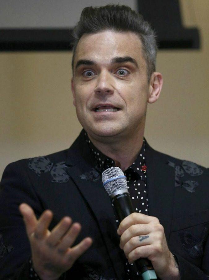 Robbie Williams, la recensione del nuovo album Heavy Entertainment Show. E la data italiana dell'atteso tour