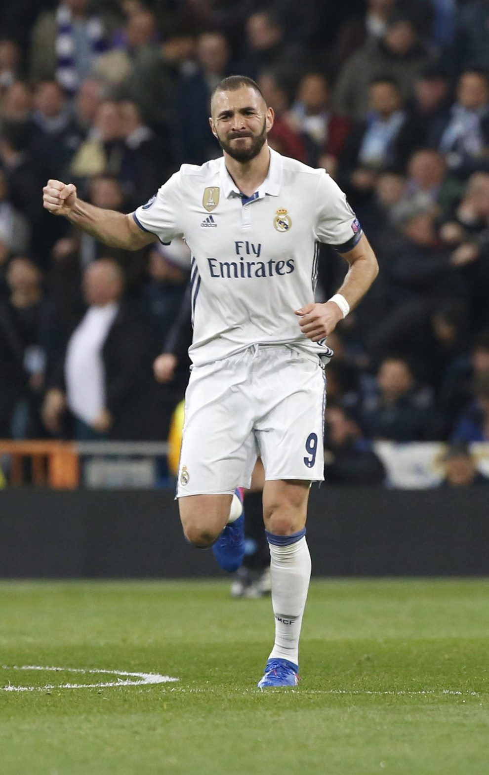 Real Madrid's French striker Karim Benzema jubilates a goal, the first against Napoli, during their UEFA Champions League round of 16 match at Santiago Bernabeu stadium in Madrid, Spain, 15 February 2017. EFE/Kiko Huesca