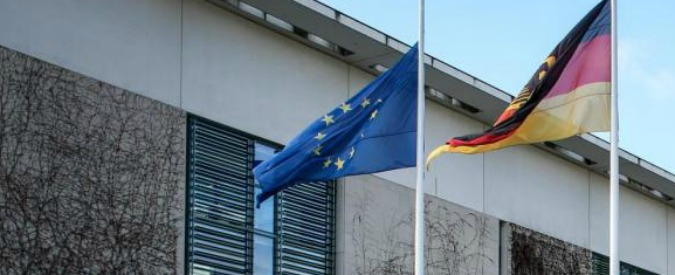 (151114) -- BERLIN, Nov. 14, 2015 (Xinhua) -- A woman walks by as a EU flag and a German national flag fly at half mast at the Chancellery in Berlin, Germany, on Nov. 14, 2015. Over 100 people were killed in a mass hostage-taking at a Paris concert hall Friday and many more were feared dead in a series of bombings and shootings. (Xinhua/Zhang Fan)
