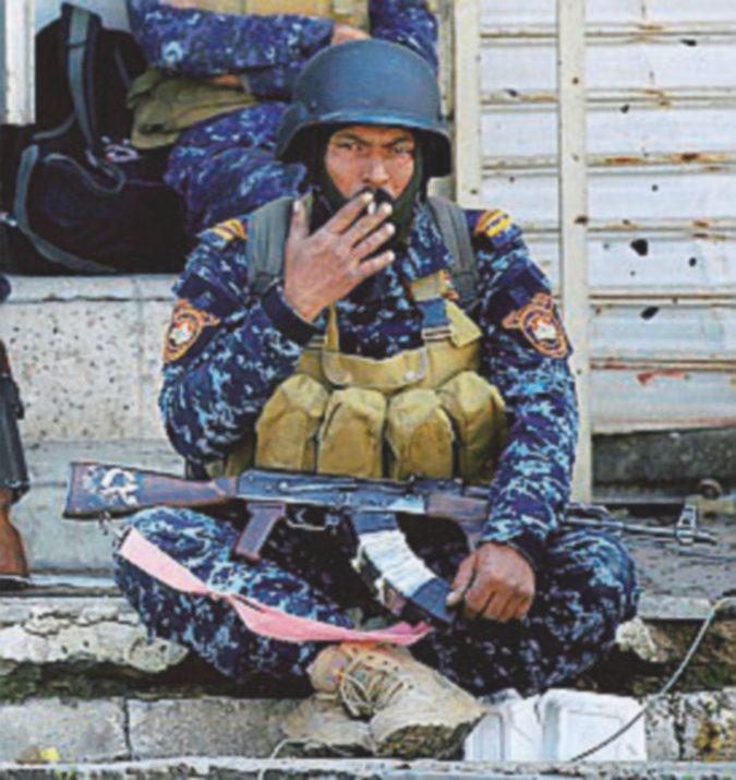 Le 14 regole dell'Isis sul muro della chiesa a Mosul: pena di morte per chi bestemmia