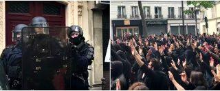 """Parigi, tensione al corteo anti Macron. Sindacalista contro il poliziotto: """"Abbassi quell'arma"""""""