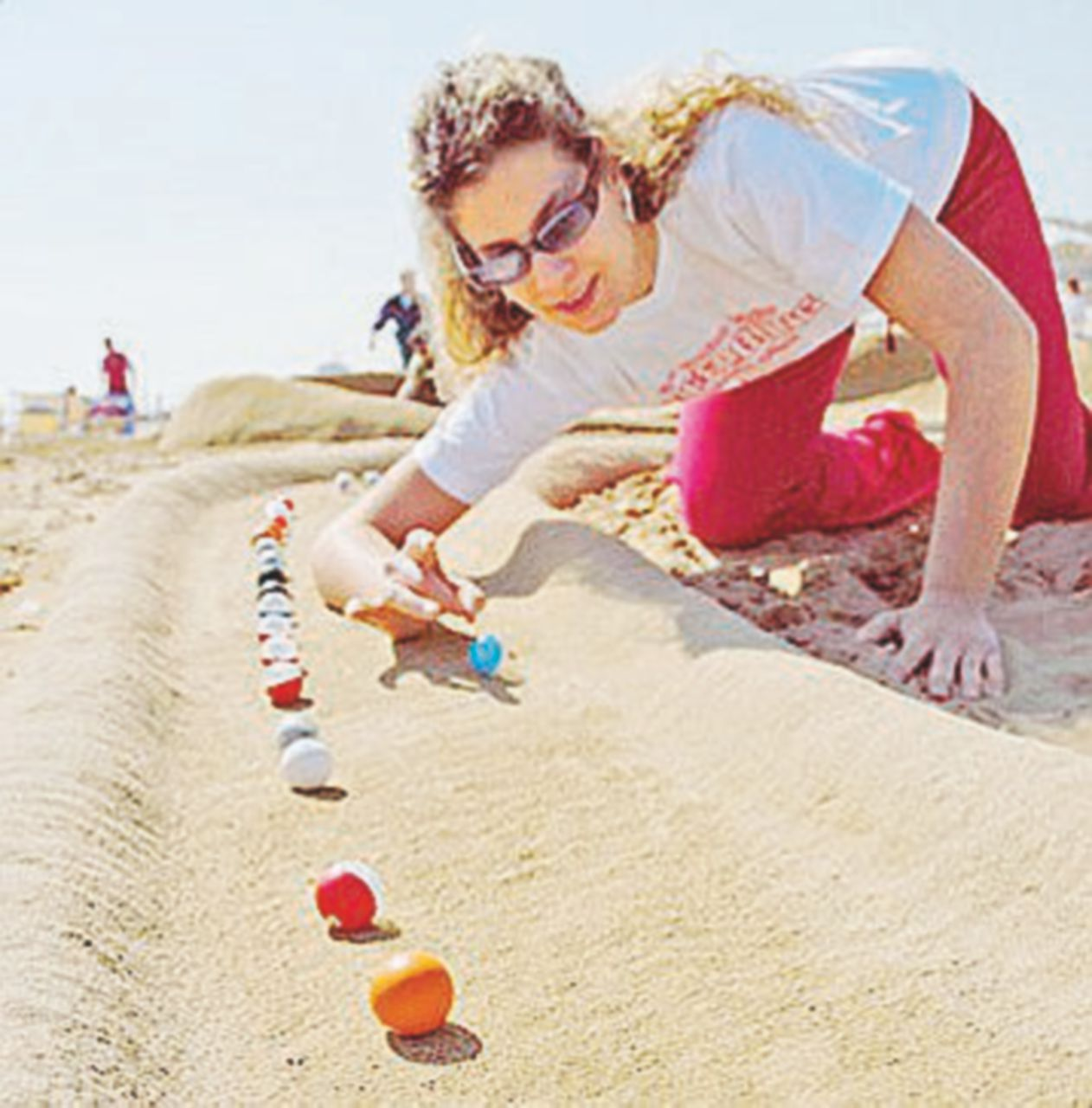 Facciamolo Cheecoting Sfida di biglie in spiaggia