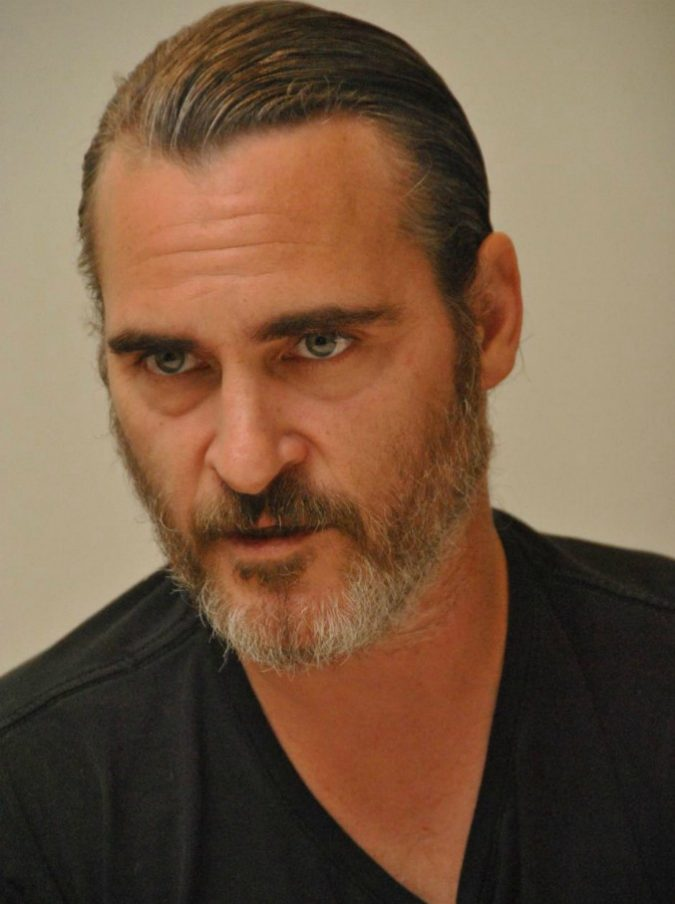 Joaquin Phoenix sarà il nuovo Joker: l'attore visibilmente dimagrito nelle prime foto dal set