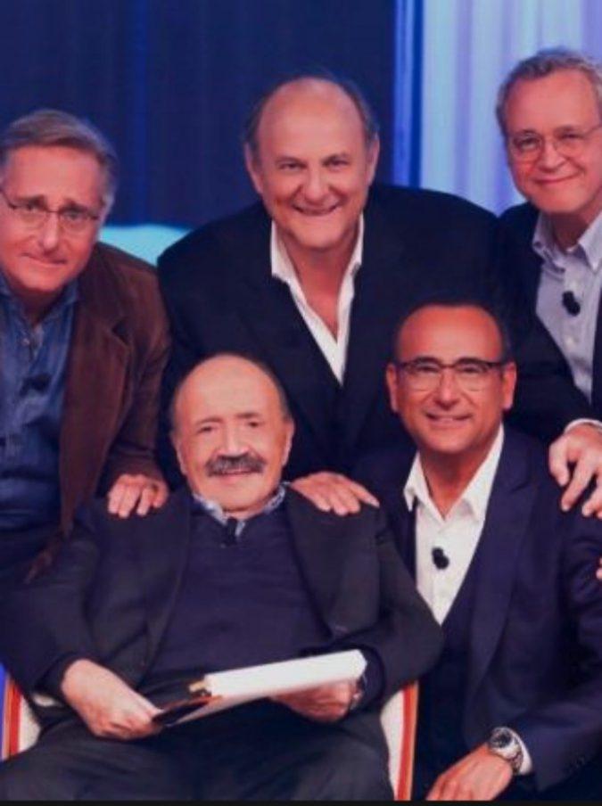 """Al Maurizio Costanzo Show il trio Paolo Bonolis, Carlo Conti e Gerry Scotti fa il pieno di ascolti: """"Avrebbe dovuto esserci anche Frizzi"""""""