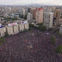 In this aerial view thousands of people protest in Santiago, on October 25, 2019, a week after violent protests started. – Demonstrations against a hike in metro ticket prices in Chile's capital exploded into violence on October 18, unleashing widening protests over living costs and social inequality. (Photo by Pedro Ugarte / AFP)