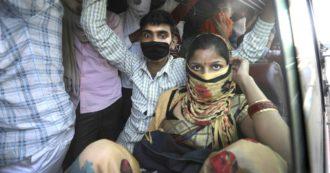 Coronavirus, esodo biblico in India dopo il lockdown: lavoratori disperati tornano dalle città ai villaggi – FOTO