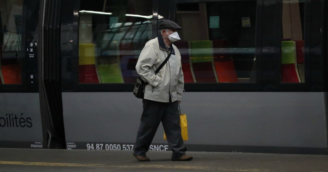 A man wearing a face mask walks on the platform at the Saint Lazare train station Monday, May 11, 2020 in Paris. France is begin to reopen Monday after two months of virus confinement measures. Shops, hair salons and some other businesses are reopening Monday and French citizens no longer need a special permission form to leave the house. (AP Photo/Francois Mori)