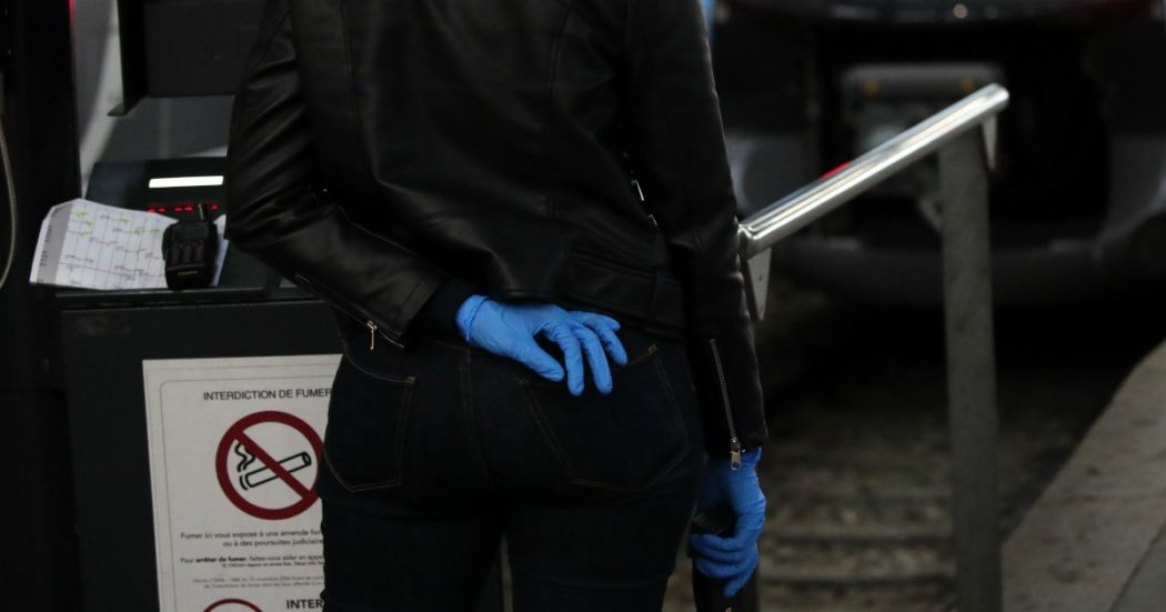 A woman wearing gloves wait at the Saint Lazare train station Monday, May 11, 2020 in Paris. France is begin to reopen Monday after two months of virus confinement measures. Shops, hair salons and some other businesses are reopening Monday and French citizens no longer need a special permission form to leave the house. (AP Photo/Francois Mori)
