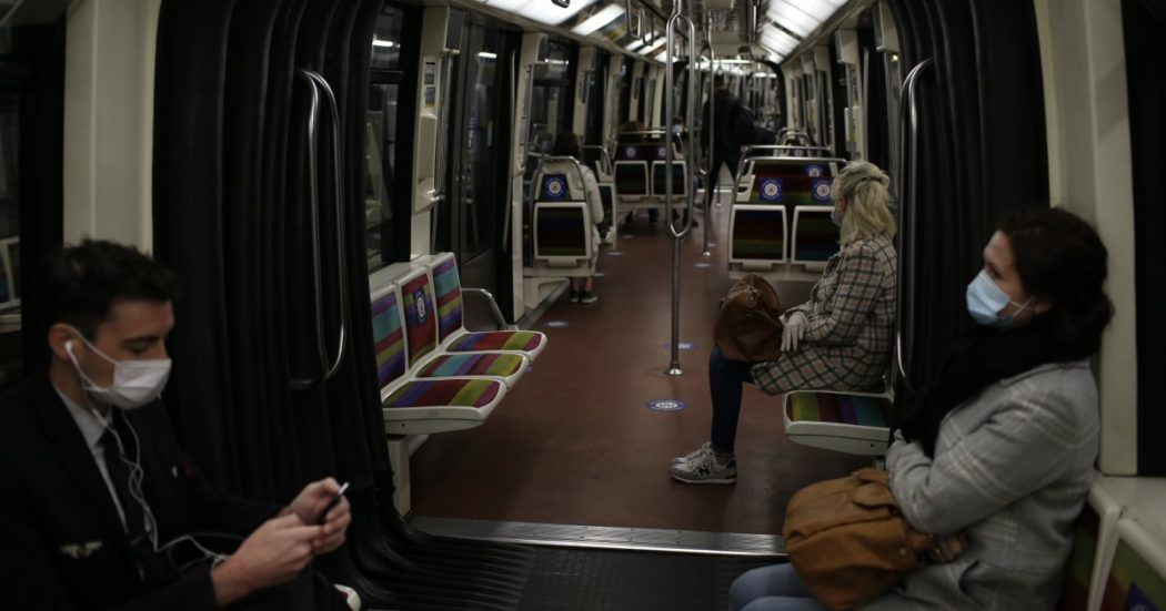 People, wearing the compulsory face mask, sit in a subway train Monday, May 11, 2020 in Paris. The French began leaving their homes and apartments Monday for the first time in two months without permission slips as the country began cautiously lifting its virus lockdown. (AP Photo/Rafael Yaghobzadeh)