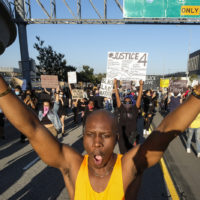 Demonstrators march during a protest of the death of George Floyd, a black man who was in police custody, in Minneapolis, in downtown Los Angeles, Wednesday, May 27, 2020. (AP Photo/Ringo H.W. Chiu)