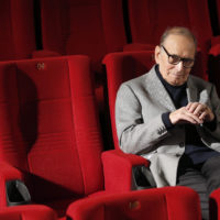 "FILE – In this Dec. 6, 2013 file photo, Italian composer Ennio Morricone poses during a photo call to promote his German 2014 concerts, in Berlin, Germany. Morricone, who created the coyote-howl theme for the iconic Spaghetti Western ""The Good, the Bad and the Ugly"" and the soundtracks such classic Hollywood gangster movies as ""The Untouchables,"" died Monday, July 6, 2020 in a Rome hospital at the age of 91. (AP Photo/Michael Sohn, file)"