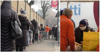 Milano, centinaia di persone in coda per avere un pasto: le immagini delle lunghe file