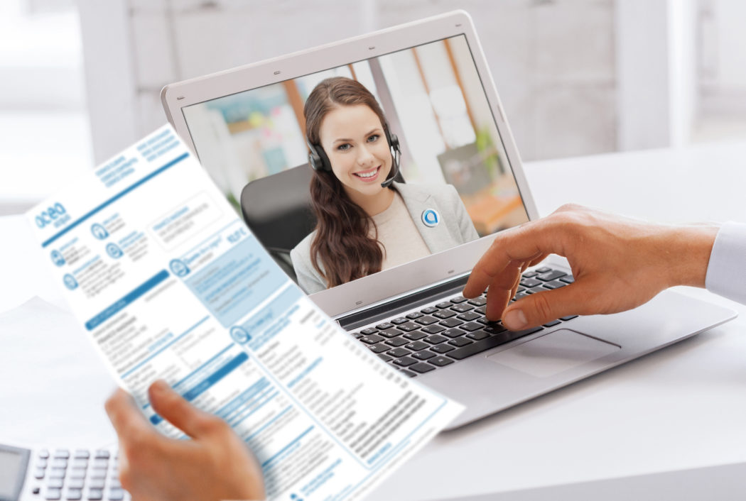 business, technology and communication concept – close up of businessman with laptop computer having video call with customer service operator, partner or secretary at office