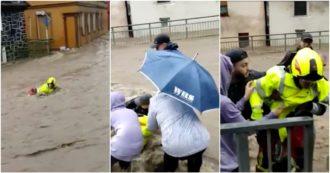 Inondazioni in Germania, i residenti salvano un pompiere trascinato dalla furia dell'acqua (video)