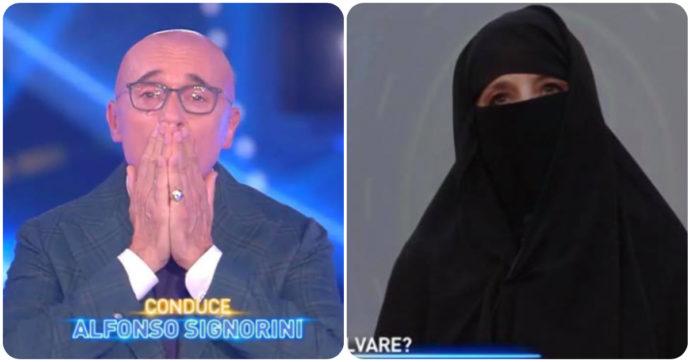 """Grande Fratello Vip, Jo Squillo con il niqab per le donne afghane. Alfonso Signorini: """"Mica posso vederti tutta la puntata così, mi fai una certa impressione"""""""